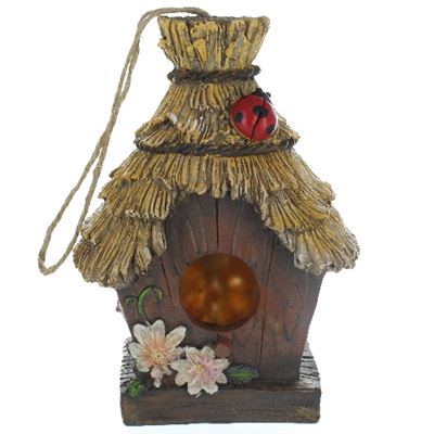 Bird House with Thatched Roof and Ladybird