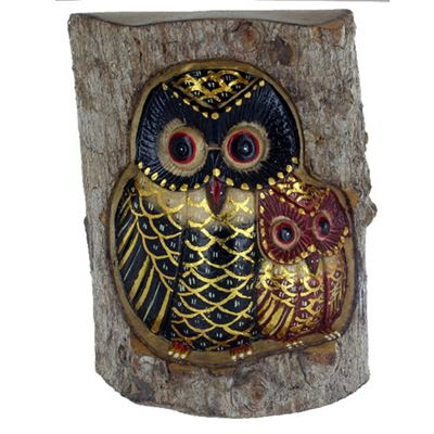 Painted Carved Owls in Tree Trunk